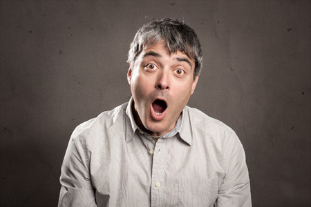 portrait of man with surprised expression photo