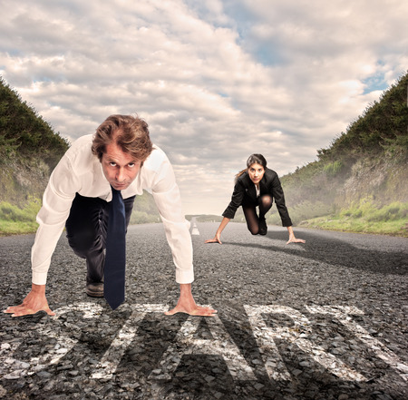 man versus woman on a road ready to run photo