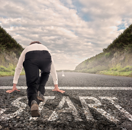 one lane: businessman on a road ready to run. Motivation concept Stock Photo