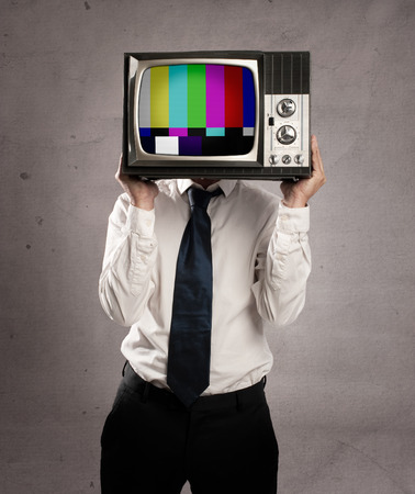 businessman with old retro television on his head photo