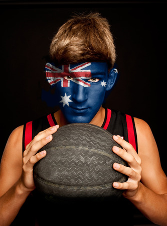australia flag: portrait of basketball player with australian flag painted on his face