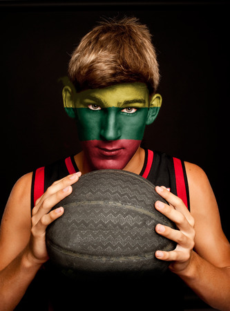 lithuanian: portrait of basketball player with lithuanian flag painted on his face