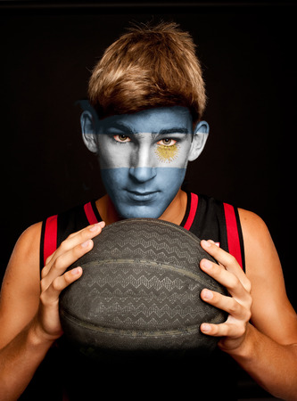 argentinian flag: portrait of basketball player with argentinian flag painted on his face Stock Photo