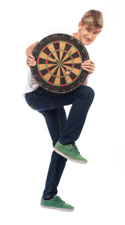 young man holding a dartboard on white background photo