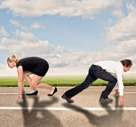 one lane: man versus woman on a road ready to run