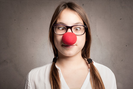 clown nose: happy young girl with a clown nose