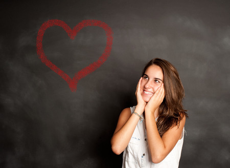 truelove: portrait of young girl thinking in front of chalkboard