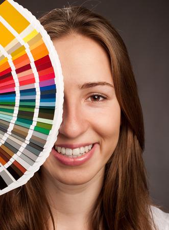 pantone: young woman holding a pantone palette