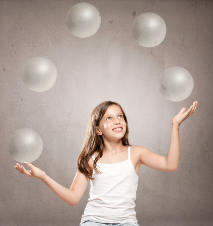 juggling: little girl juggling with crystal sphere balls Stock Photo