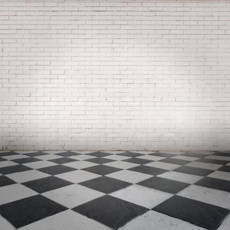 ladrillo: habitación con ladrillos de la pared blanca y suelo gris