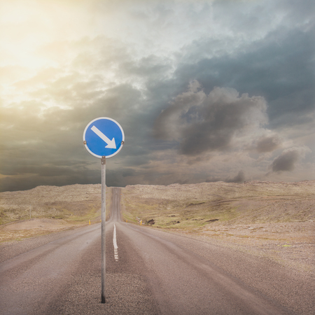 one lane street sign: asphalt road with one way Road Sign Stock Photo