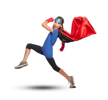 little girl wearing a superhero costume on white background Archivio Fotografico
