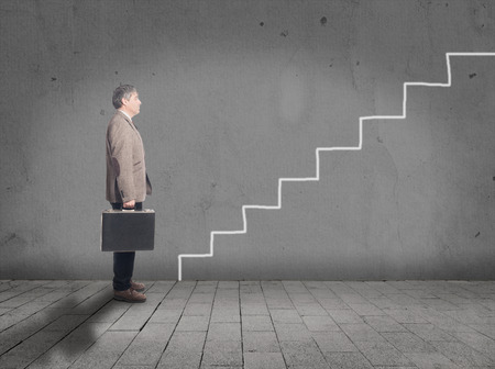 starter: Businessman in front of drawing stairs