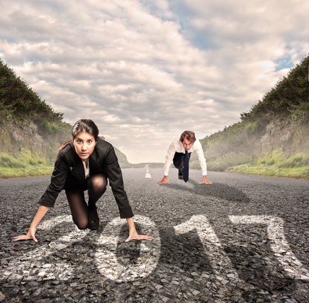 run way: man versus woman on a road with year 2017 painted on it Stock Photo