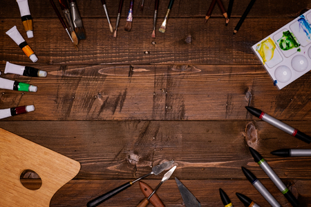 painting tools on wooden background