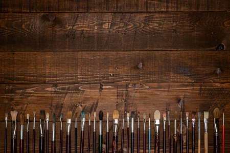 paintbrushes on wooden background Stockfoto