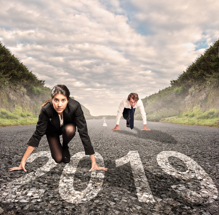 man versus woman on a road with year 2019 painted on it Stockfoto