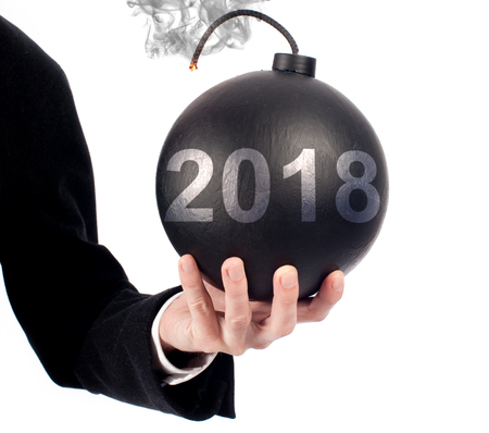 businessman hand holding an old-fashioned bomb. Start of year 2019 concept