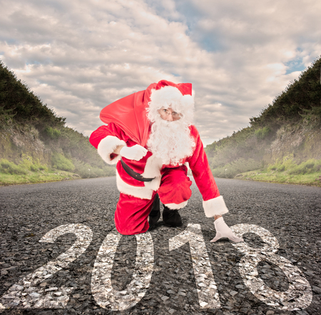 santa claus on a road ready to run. 2018 christmas concept