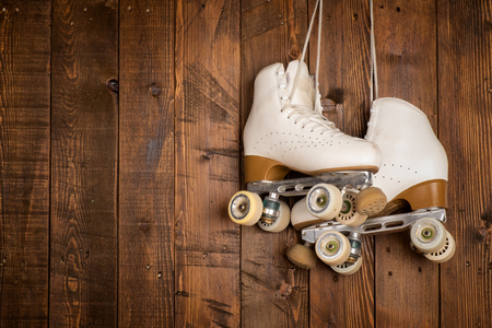 roller skates on a wood background