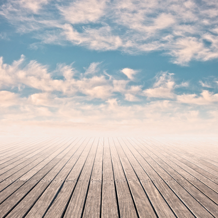 pier in a cloudy blue sky on sunset