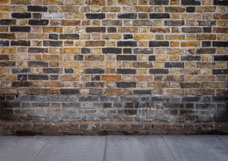 street with bricks wall and grey cement floor