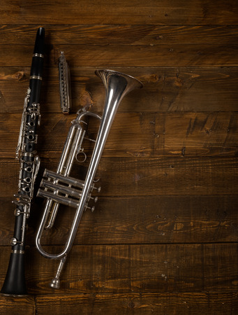 wind instruments in wooden background