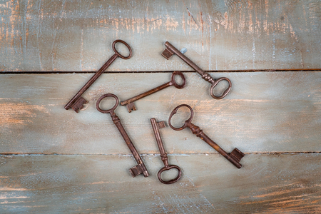 old keys in wooden background
