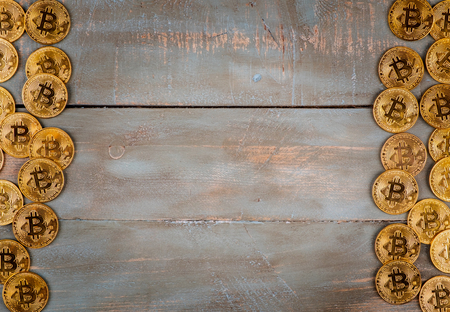 bitcoins in wooden background