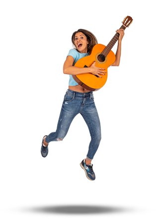 woman jumping with classic guitar in her hands isolated on white
