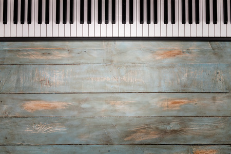 piano keyboard in wooden background