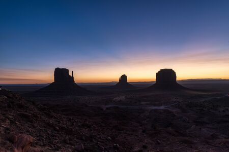 A colored sunrise over the Mitten Buttes