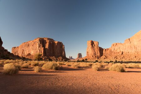 A sunset view of the arid lands in Monument Valley with the tables at the back