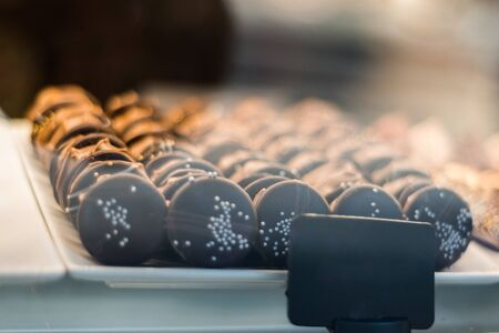 A display window with chocolate cookies in a tray