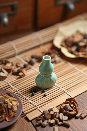 medicine cabinet: Chinese medicine pill bottles and medicinal herbs in traditional Chinese medicine cabinet