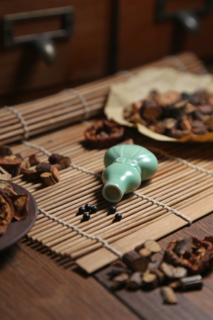 medicinal herbs: Chinese medicine pill bottles and medicinal herbs in traditional Chinese medicine cabinet