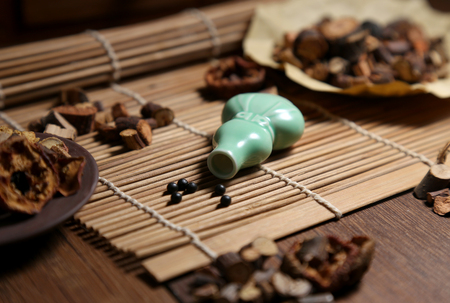 regimen: Chinese medicine pill bottles and medicinal herbs in traditional Chinese medicine cabinet