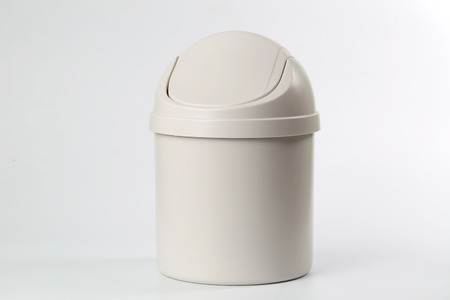 wastepaper basket: In front of a white background the trash