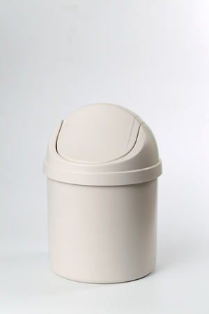 wastebasket: In front of a white background the trash