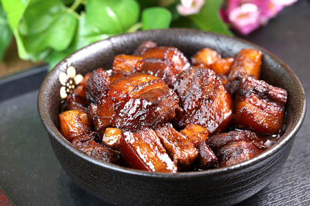 A large bowl of Braised pork in brown sauce Stock Photo