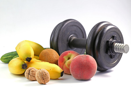 Healthy lifestyle dumbbell exercise and fruit