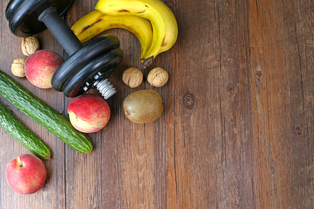 muscle fiber: Healthy lifestyle dumbbell exercise and fruit