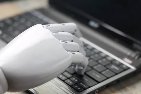 artificial: artificial intelligence hand type on keyboard