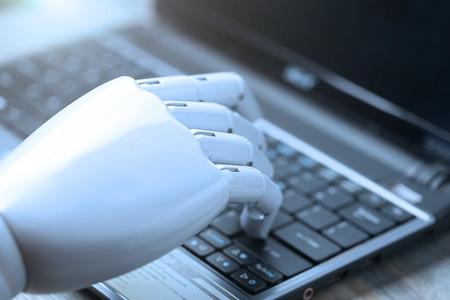 artificial intelligence hand type on keyboard Reklamní fotografie