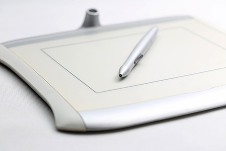 graphic tablet: graphic tablet and pressure sensitive pen on white background Stock Photo
