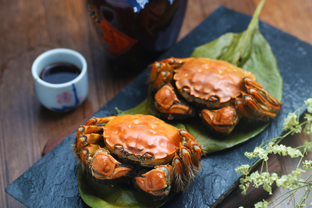 steamed crabs of China Yangcheng lake on stone board Stock Photo