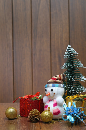 snowman wood: Christmas tree  gift box and snowman on wood desk
