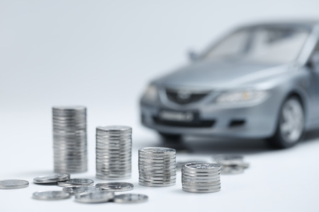 coin stacks in front of car