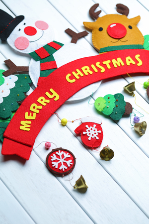 Christmas gift box cloth art adornment and golden ball on the white board