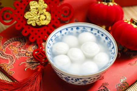 sweet rice dumplings in blue and white porcelain bowl,Chinese Lantern Festival Stock Photo